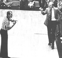 Coach Norm Stewart challenges a referee