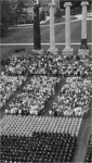 Aerial Shot of Seated Graduates and Audience near Columns