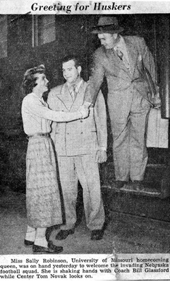 MU homecoming queen, Sally Robinson, Greets University of Nebraska Players and Coach, 1949