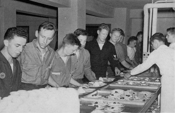 Naval students receiving their mess hall meals
