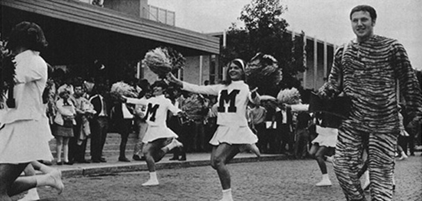 Mascot marching with cheerleaders, 1970