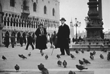 Sara Lockwood Williams and Walter Williams, President of the University of Missouri, in the Piazza San Marco, Venice. Still image from 16mm film, 1933.