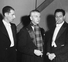 Vladimir Golschmann, conductor of the Saint Louis Symphony, is flanked by two members of his orchestra at a concert by the Symphony at MU, ca. 1948. Golschmann was awarded an honorary Doctor of Music degree by the University in 1954. The photo was taken by Robert Tonn.