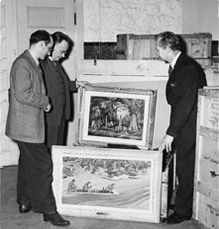 Fred Shane, Elmer Ellis, and Douglas Hansen look at paintings from the Scruggs - Vandervoort - Barney 'Missouri - Heart of the Nation' Collection. The upper painting is Shane's 'The Old Cemetery'; the lower is Howard Baer's 'Floatin' Fishing'.
