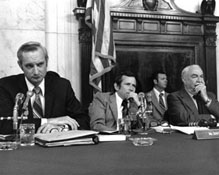 Deputy Minority Counsel Donald Sanders, Senator Howard Baker, and Senator Sam Ervin during a hearing of the Senate Select Committee on Presidential Campaign Activities (Watergate Committee), ca. 1973.