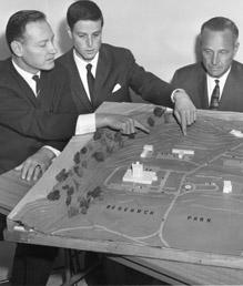 Chancellor John Schwada inspects model of Research Park development.